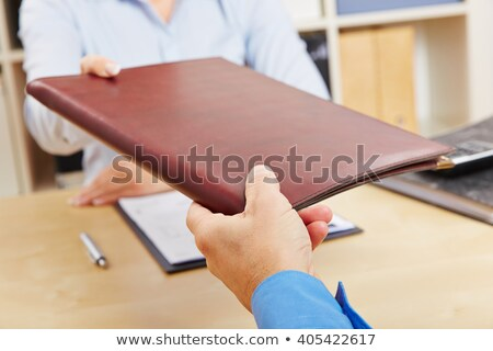 Hands of man giving application portfolio to HR man in office fo Stock photo © snowing