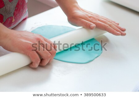 Woman icing sugar on dough Stock photo © wavebreak_media