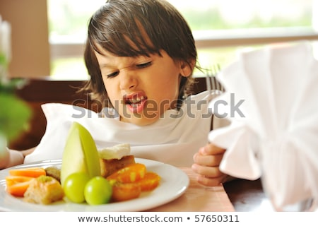Refusing food, kid does not want to eat Stock photo © zurijeta