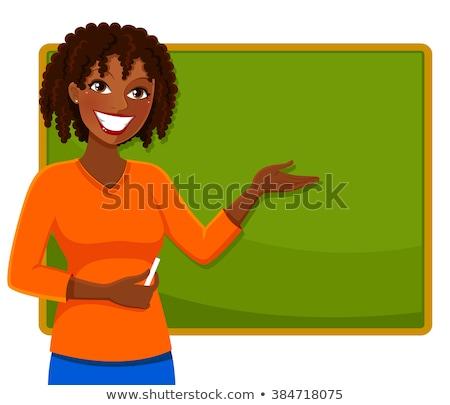 woman standing next to blackboard Stock photo © IS2