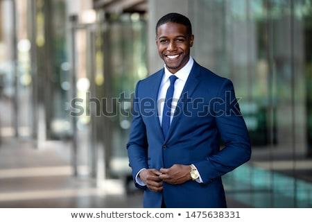 Afryki człowiek biznesu młodych przystojny stwarzające odizolowany Zdjęcia stock © hsfelix