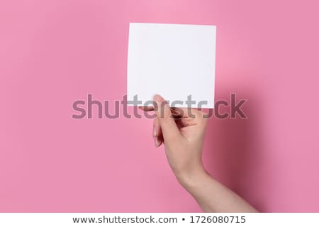 Woman holding instant camera blank frame. Stock photo © RTimages