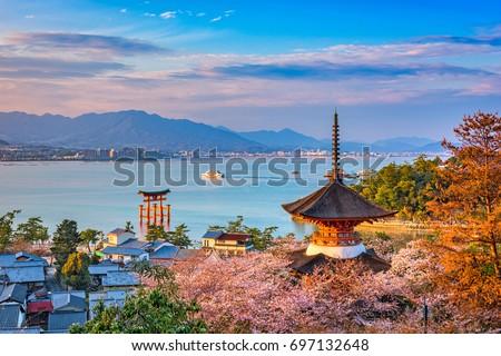 santuário · ilha · céu · água · pôr · do · sol · paisagem - foto stock © boggy