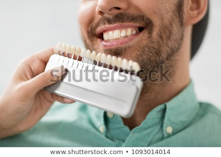 happy smiling male patient at dental clinic Stock photo © dolgachov