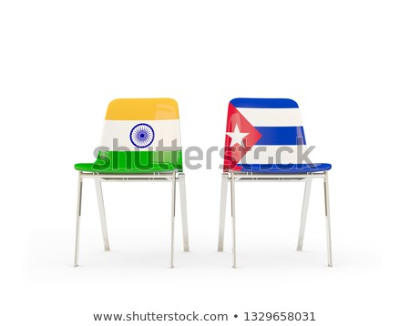 Two chairs with flags of India and cuba Stock photo © MikhailMishchenko