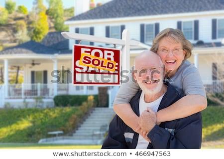 izgatott · férfi · eladva · ingatlan · felirat · ház - stock fotó © feverpitch