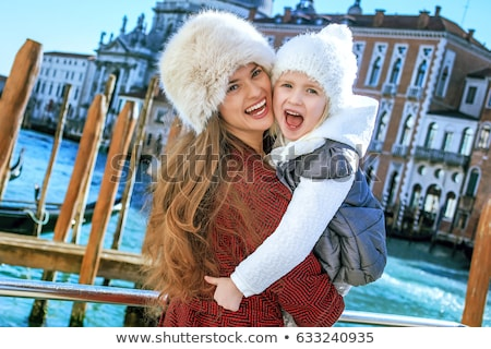 Another world vacation. Portrait of smiling modern mother and child travellers in Venice, Italy in t Stock photo © ElenaBatkova
