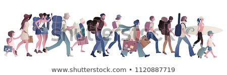 travelers group walking with map backpackers stock photo © robuart