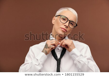 Close up portrait of short haired female general practitioner stands with smile and arms crossed, us Stock photo © vkstudio