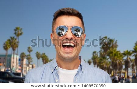 笑い 男 サングラス ヴェネツィア ビーチ 夏 ストックフォト © dolgachov