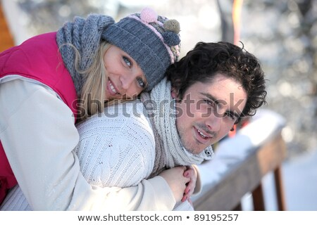 Couple stood on chalet decking Stock photo © photography33