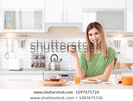Woman eating a piece of bread with jam Stock photo © photography33