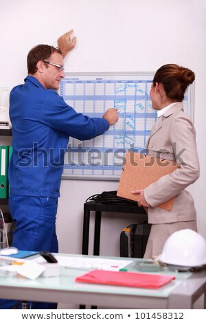 Construction foreman arranging a meeting with an engineer Stock photo © photography33