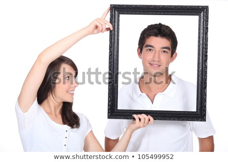 Couple stood with empty picture frame Stock photo © photography33