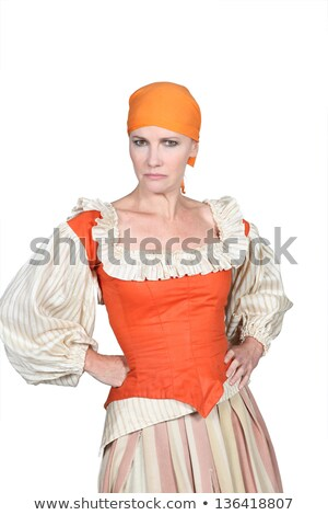 Woman in pantomine outfit, frowning with her hands on her hips Stock photo © photography33