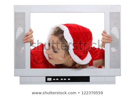 Woman with Christmas hat behind TV Stock photo © photography33