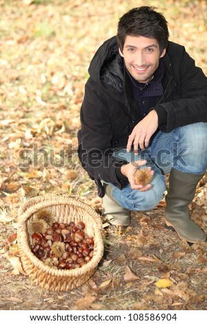 landscape picture of young picking chestnuts stock photo © photography33