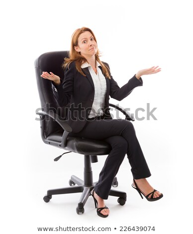Shrugging businesswoman in office chair Stock photo © elenaphoto