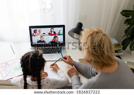 Kobieta pomoc wnuczka praca domowa dziewczyna świecie Zdjęcia stock © photography33