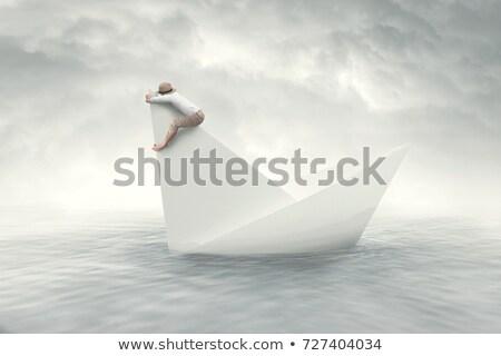 Fehér papír csónak süllyed tenger víz Stock fotó © cherezoff