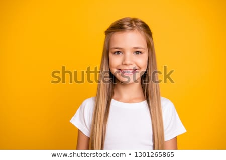 Portrait of blonde girl with toothy smile. Stock photo © NeonShot