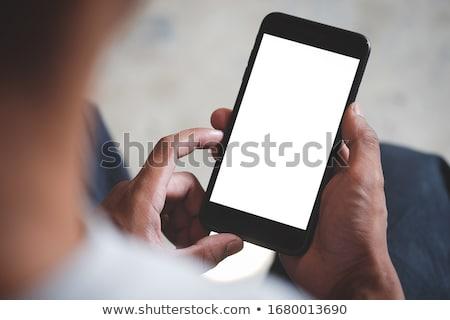 бизнесмен рук мобильного телефона экране свободный Сток-фото © sabelskaya