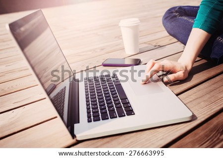 businesswoman sitting on the floor with arm up and laptop asking for attention Stock photo © ambro