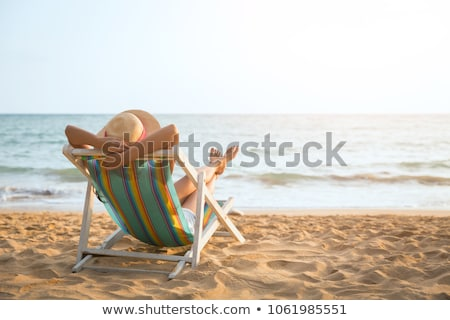 young woman relaxing on a bench at the sea stock photo © dash