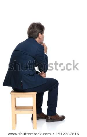 Elegante uomo suit seduta studio toccare Foto d'archivio © feedough