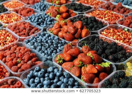 Strawberries, blueberries and raspberries for sale Stock photo © elxeneize