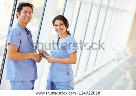 kettő · női · nővérek · áll · kórház · folyosó - stock fotó © monkey_business