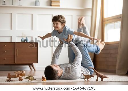 család · játszik · együtt · játék · mosolyog · törődés - stock fotó © IS2