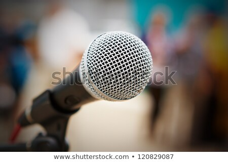Close-up of microphone  against musicians performing against wall at club Stock photo © wavebreak_media