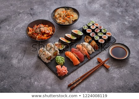 various kinds of sushi placed on black stone board stock photo © dash