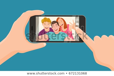 portrait of three friends taking photos with a smartphone stock photo © dashapetrenko
