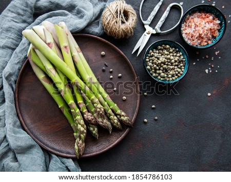 Bunch Of Asparagus With Spices On A Plate Stock fotó © almaje