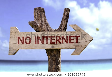 No Internet Wooden Directional Arrow Sign On Beach Stock photo © AndreyPopov