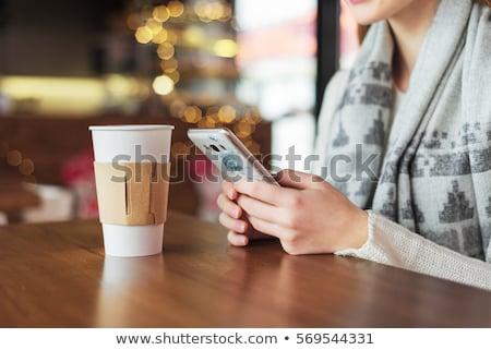 Genç kadın cep telefonu lokanta güzel kız gülümseme Stok fotoğraf © boggy