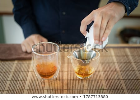 Mãos moço bule fresco chá medicinal Foto stock © pressmaster