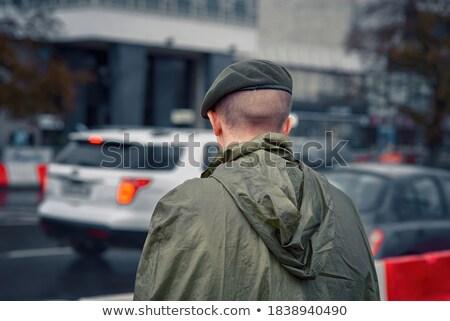 Soldaat permanente regenachtig weer gewapend achtergrond Stockfoto © ra2studio