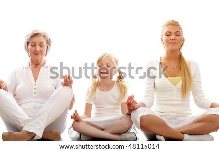 Grandmother and granddaughter meditating together Stock photo © dashapetrenko