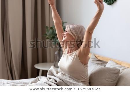 vrouw · vergadering · bed · ochtend - stockfoto © wavebreak_media