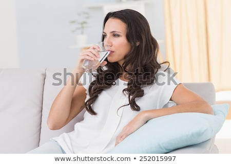 Barna hajú pohár víz nő mosoly modell Stock fotó © photography33