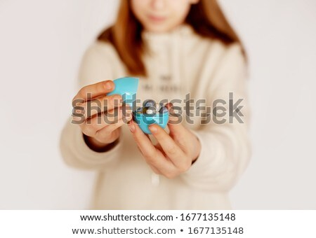 Woman holding a large chocolate Easter egg Stock photo © photography33