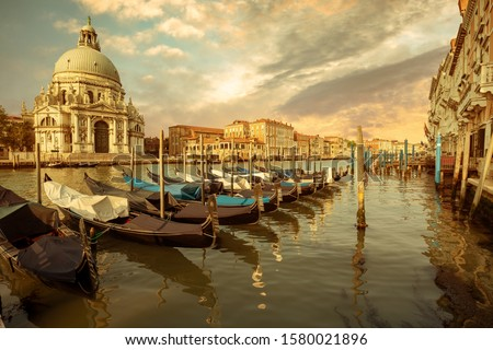 gondolas moored in row on grand canal in venice stock photo © rglinsky77