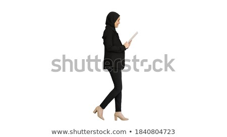 Stock photo: Young smiling business woman with tablet computer. Isolated on w