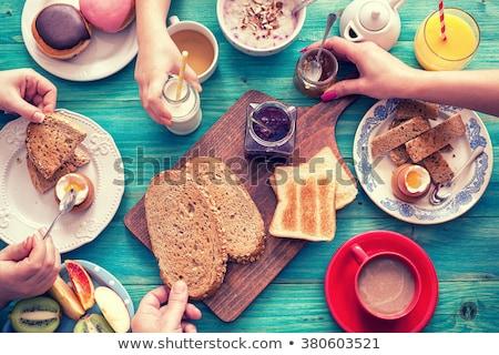 Child on breakfast  Stock photo © HASLOO