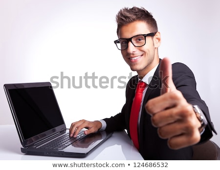 side of young business man with laptop looking up with hand on stock photo © feedough