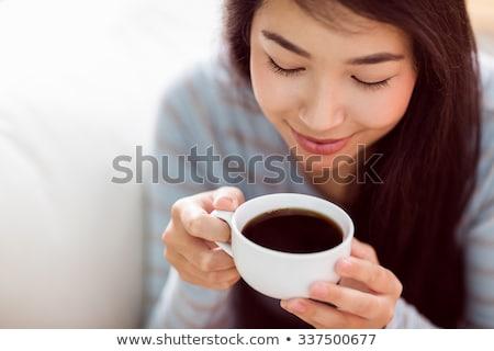 Genç mutlu kadın içme kahve güzel bir kadın Stok fotoğraf © jeliva
