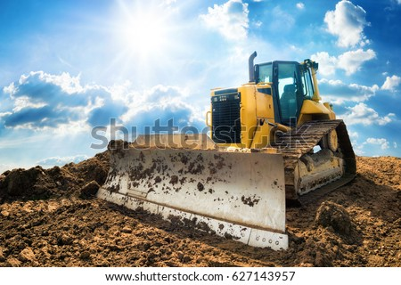 Stock photo:  big yellow bulldozer at work-site